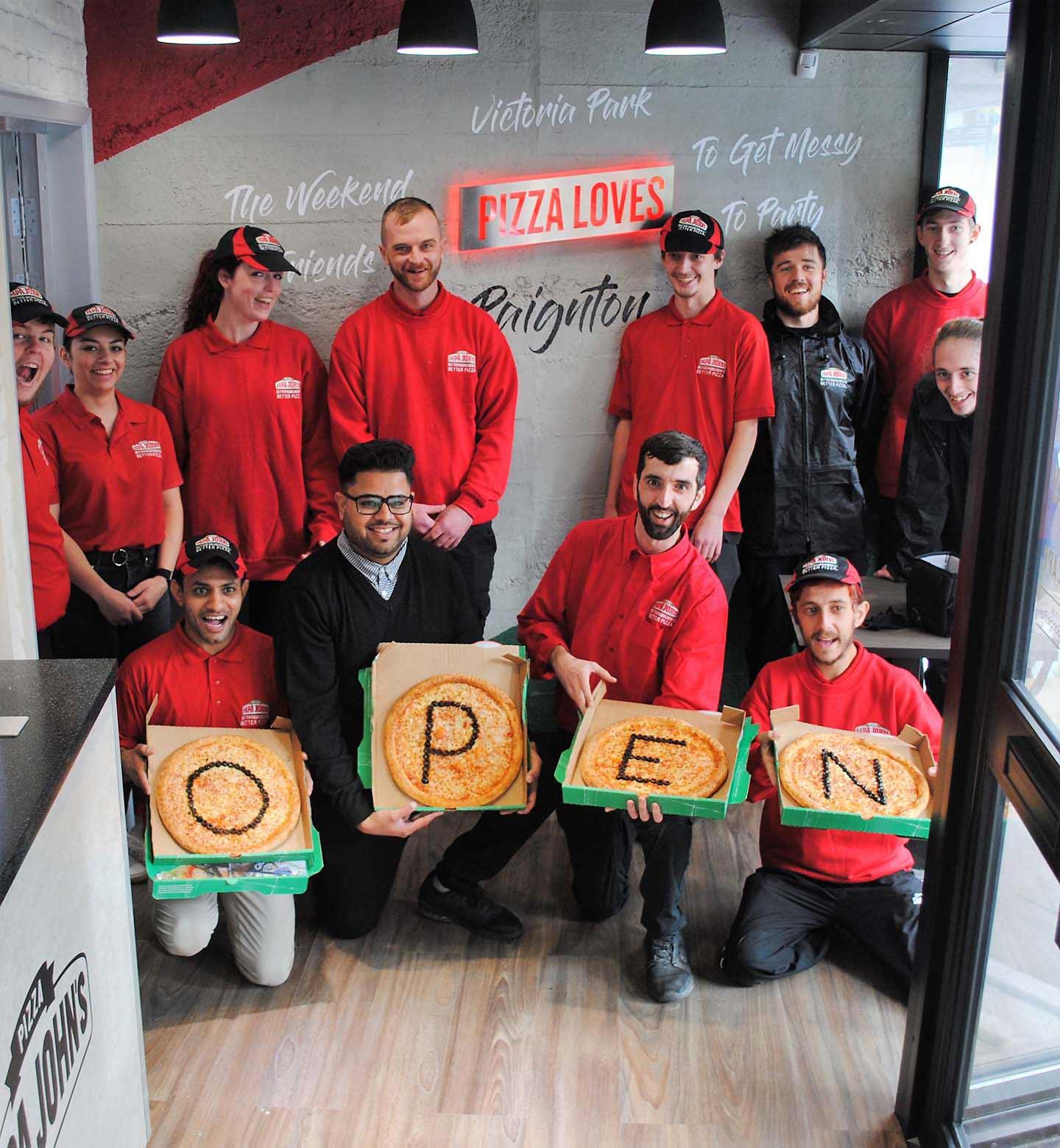 Muhammad Abid's store team celebrates opening